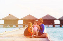 Father with two kids on tropical vacation Stock Photos