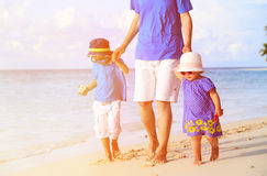 Father and two kids walking on tropical beach Royalty Free Stock Image