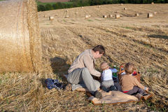 Father and two little boys making evening picnic Stock Images