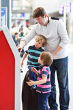 Father and two little sibling boys at the airport Royalty Free Stock Image
