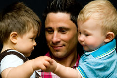 Father with two sons. Family portrait of a father with two baby sons Royalty Free Stock Photography