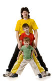 Father with two sons. In multi-coloured sport clothes stand full size, isolated on white Royalty Free Stock Image
