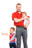 Father with two sons. Studio shot Royalty Free Stock Photos