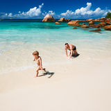 Father and two year old boy playing on beach Royalty Free Stock Images