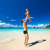 Father and two year old boy playing on beach Stock Photos