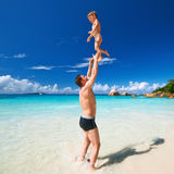 Father and two year old boy playing on beach. Two year old baby boy and his father playing on beach at Seychelles stock image