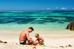 Father and two year old boy playing on beach Royalty Free Stock Photos
