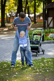 Father with two year old son in summer park Royalty Free Stock Image