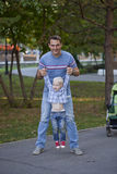 Father with two year old son in summer park Royalty Free Stock Images