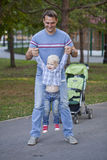 Father with two year old son in summer park Royalty Free Stock Photography