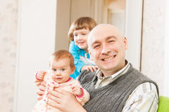 Father and two young daughters Stock Photo