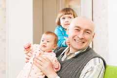 Father and two young daughters Royalty Free Stock Photos