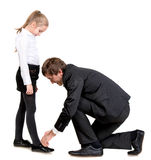 Father tying daughter's shoelaces Stock Photos