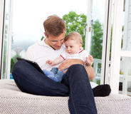 Father Using Digital Tablet with Son Stock Photography