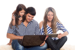 Father using a laptop, tablet PC, smartphone Stock Photos