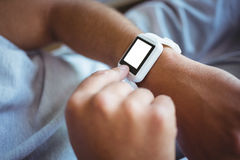 Father using a smart watch Royalty Free Stock Photo