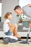 Father vacuum cleaning at home Stock Photo