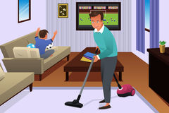 Father Vacuuming the Carpet in the House Royalty Free Stock Photos