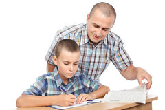 Father verifying son's homework Royalty Free Stock Photography