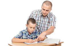 Father verifying son's homework Royalty Free Stock Images