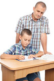 Father verifying son's homework Stock Photography