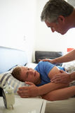 Father Waking Up Teenage Son Royalty Free Stock Image