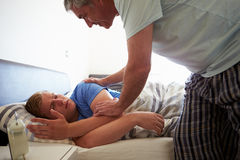 Father Waking Up Teenage Son Stock Images