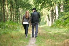 Father walking with daughter in the forest Royalty Free Stock Photo