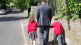 Father Walking To School With Children On Way To Work stock video