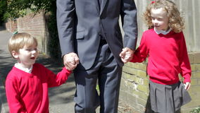 Father Walking To School With Children On Way To Work Royalty Free Stock Images