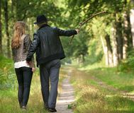 Father walking in the woods with daughter Royalty Free Stock Photos