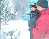 Father walks with little son at winter park Stock Images