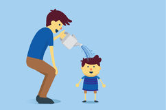 Father watering a son Royalty Free Stock Images