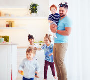 Father with weird hairstyle looking after mad kids at home Royalty Free Stock Images