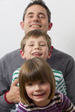 Father wiht his kids Stock Image