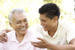 Free Father With Adult Son In Park Royalty Free Stock Photography - 12405397