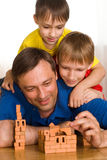Father With Children Playing Stock Images