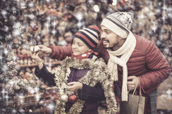 Free Father With Small Girl Choosing Christmas Decorations Stock Photo - 95169440