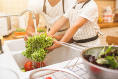 Father With Son Washes Vegetables Before Eating Royalty Free Stock Images