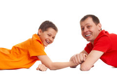 Father won. Son in arm wrestling Royalty Free Stock Photos