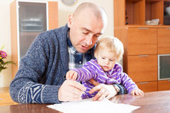 Father working  with daughter Stock Images