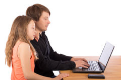 Father working with his daughter on a laptop Royalty Free Stock Photos