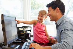 Father working in home office with daughter Royalty Free Stock Photos