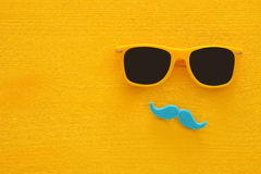 Father& x27;s day concept. Hipster yellow sunglasses and funny moustache Royalty Free Stock Image