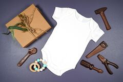 Father's Day or masculine birthday theme baby romper onesie flatlay mockup.