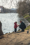Father with a young child on the Bank of the Novodevichy pond. Moscow. Royalty Free Stock Photography