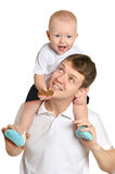 Father and a young child on a white Royalty Free Stock Photo