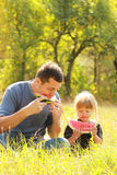 Father and young daughter eat watermelon in nature Royalty Free Stock Photos