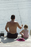 Father and young daughter fishing Royalty Free Stock Image
