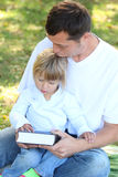 Father with a young daughter read the Bible in nature Royalty Free Stock Image